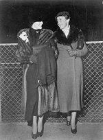 Katharine Hepburn and Laura Harding at the airport in New York awaiting their flight to Miami, where they would sail to Mexico for Hepburn's divorce from husband Ludlow Ogden Smith. - courtesy of photofestnyc.com